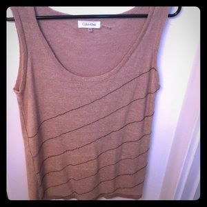 A tan Calvin Klein knit top